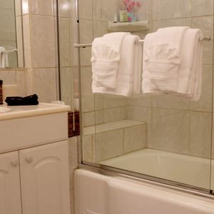 Luxurious Private bathroom with comfortable robes for your use.